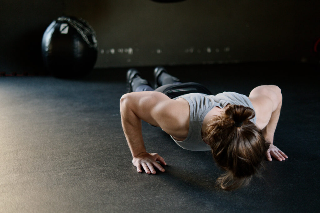 woman with muscles from doing pushups