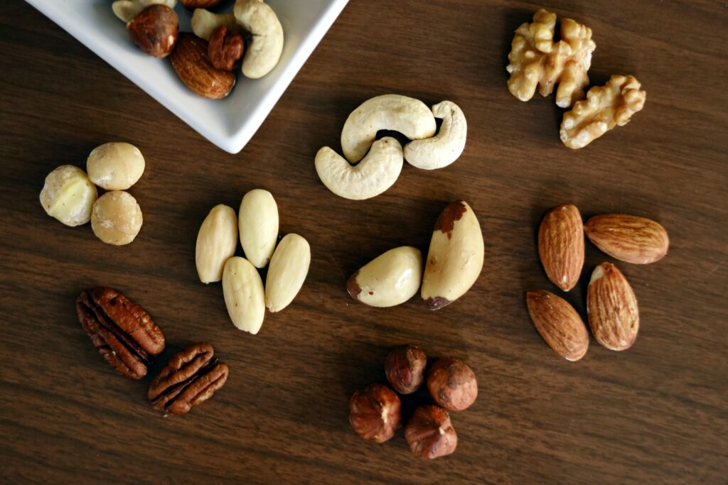 Brazil nuts next to other nuts on table