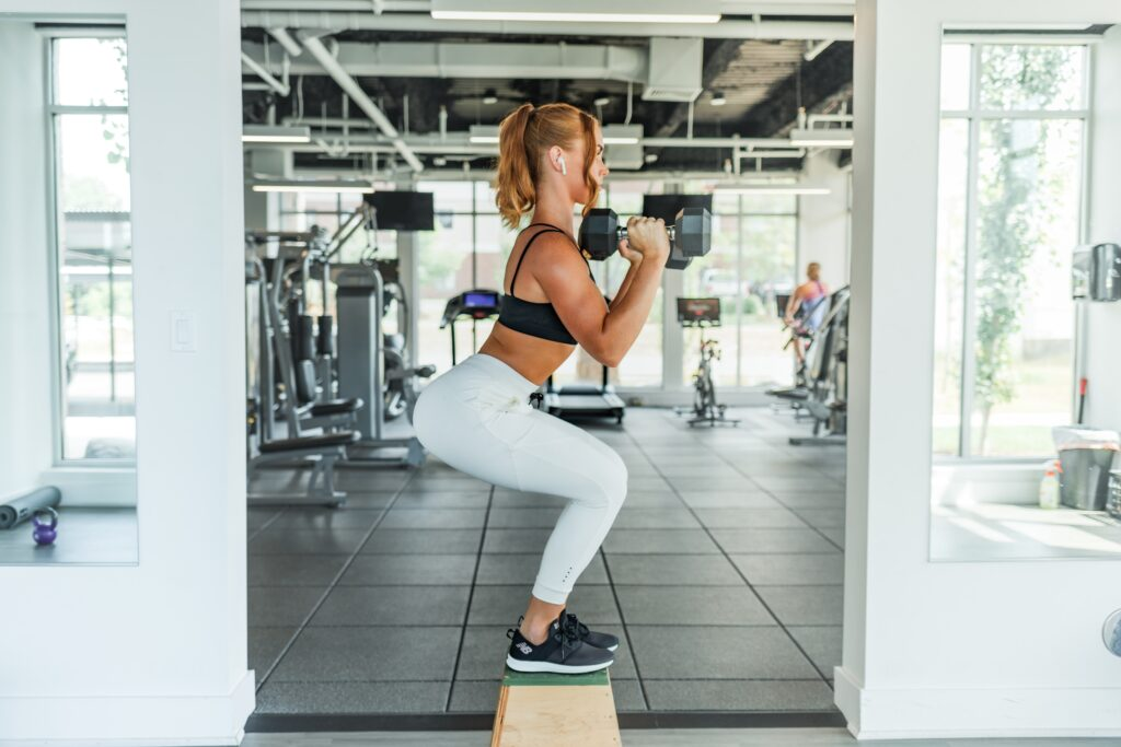 Sideview of woman doing a squat