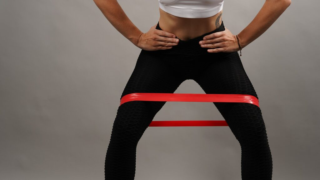 Person using resistance band to lose weight